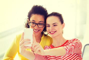 girlfriends taking selfie with smartphone camera