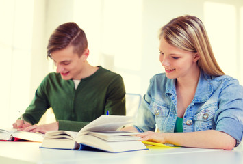 students with textbooks and books at school