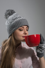 Woman winter clothes enjoying hot drink