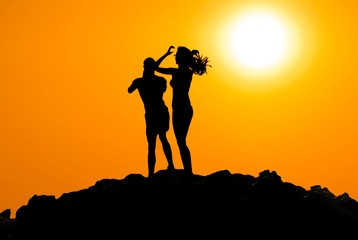 Man and woman silhouette at sunset