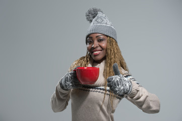 African American woman enjoying hot drink