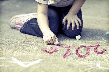 Photo of girl writing with chalk 2015 schoolyard