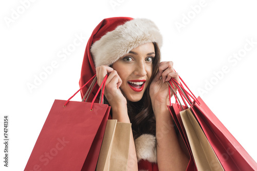 canvas print picture Woman wearing Santa Claus hat with shopping bags
