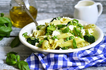 Penne with green vegetables and feta cheese.