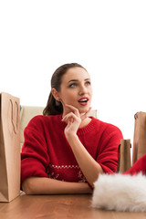 Christmas woman sitting at office with shopping bags