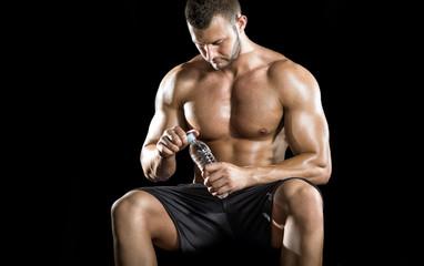 Man drinking water in gym