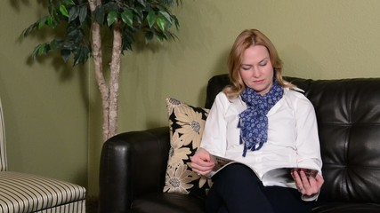 Woman reading in waiting area