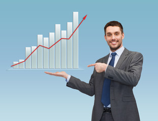 happy man showing growth chart on palm of his hand