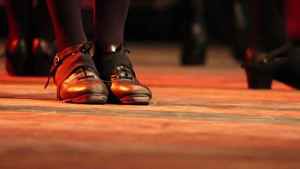 Woman dancing Irish dance on stage