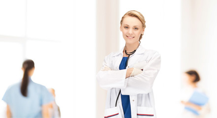 smiling young female doctor in white coat