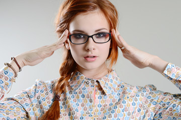 red hair girl with glasses