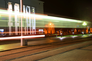 Evening traffic. The city lights. Abstract background. Tram
