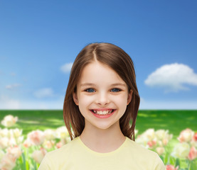 smiling little girl over white background