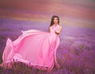 Beautiful woman on lavender meadow