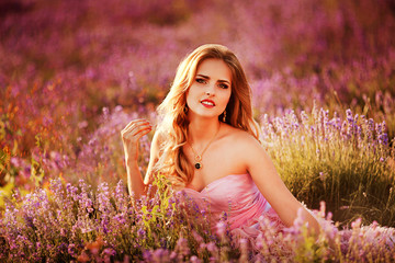 Sensual Woman Lying on a Meadow