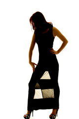 silhouette of woman in sheer dress head down hand thigh