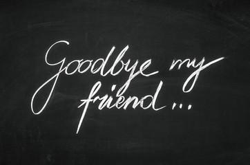 Goodbye my friend message handwritten on the blackboard