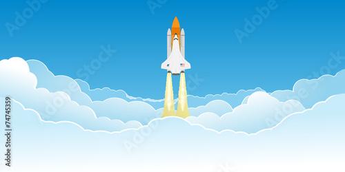 Shuttle flying in clouds.