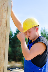 Young builder working on a building site