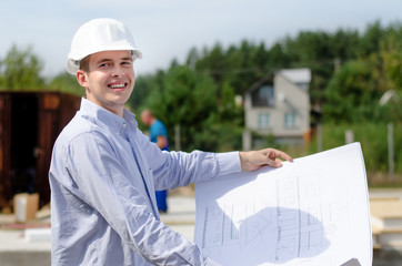 Smiling successful young architect