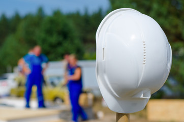 Hardhat on a pole at a building site
