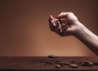 Hand letting chocolate pieces fall