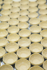 Puff of egg tart on tray ready to fill in