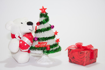 White teddy bear with christmas tree