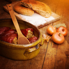 Stuffed peppers, onions and bread. Serbian cuisine.