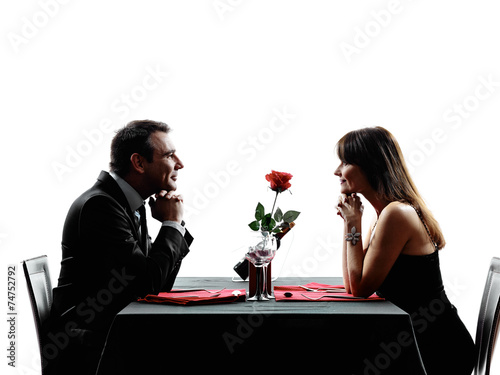 couples lovers dating dinner silhouettes - 74752792