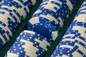 Blue Poker Chips in a Row