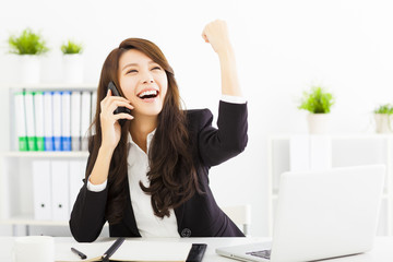 successful business woman talking on the phone in office