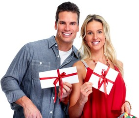 Happy couple with  envelope gift.