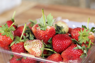 a lot of fresh strawberry fruit