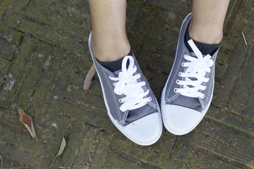 Gray sneakers with model lifestyle