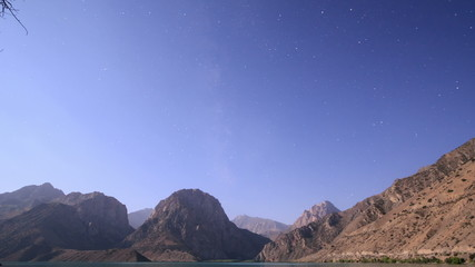 Moon over mountain lake. Zoom. Tajikistan, Iskander-Kul. Time La
