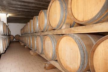 Oak barrels with red wine