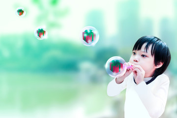 boy blowing soap bubbles. give box in the bubbles.