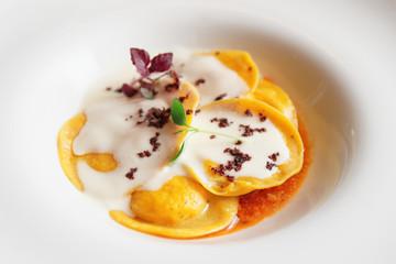 Ravioli with polenta in plate