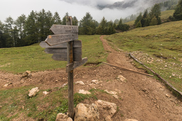 wooden board with directions in Dolomites