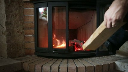 Placing wood inside fireplace