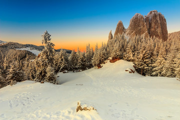 Fantastic sunset and winter landscape,Lonely-Rock,Romania,Europe