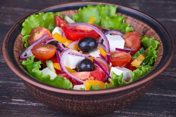 Fresh vegetable colorful greek salad in plate
