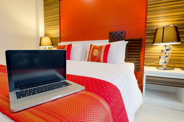 Labtop on the bed, oriental style apartment Service Room