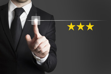 businessman pushing button rating three stars