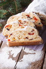 Christmas fruit cake Stollen close-up on the table. Vertical