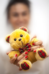 Blurry Woman Holds Bear Toy