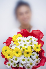 Blurry Woman Holds Daisy Flowers