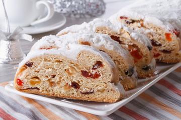 Christmas fruit bread Stollen closeup on a plate. horizontal
