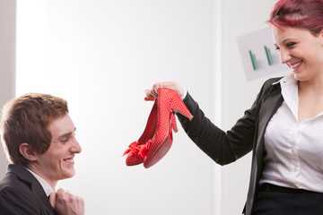business man receiving lovely red high heels shoes
